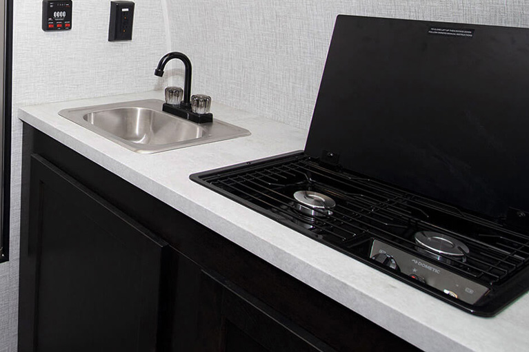 Kitchen sink with integrated faucet
